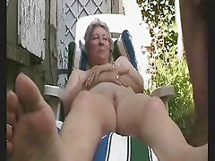 Old lady nude in court yard