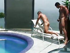 Two hunks having great oral sex near the pool