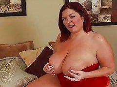 Randy redhead fat momma with big bosom masturbates on bed