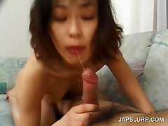 Asian cutie sucking horny pecker in bed