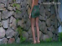 Russian teens watersports in the garden