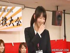 Shy asian girl shows hot leggs in a show