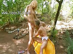 Blonde chicks dildoing in a forest