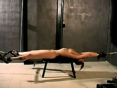Big booty redhead gets savagely punished in this BDSM scene
