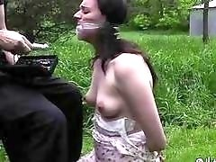 Tied up woman receives punishment outdoors from master BDSM porn