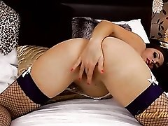 Sultry milf with big tits plays in fishnets