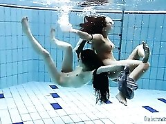 Two skinny chicks swimming naked underwater