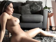 Chick is naked in the living room and posing