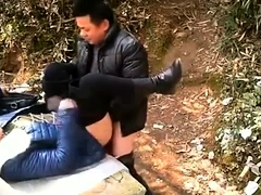 Voyeur spies on a Japanese couple having sex in the outdoors