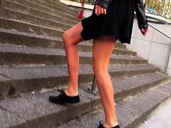 Street voyeur finds a pretty brunette with sexy slim legs