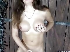 Brunette Russian T-Girl plays with hot wax and burning candle