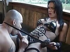 Sexy dominant amazonian shemale stretches her male captives tight ass