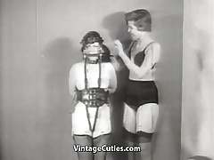 Tied up Brunette Babe in Leather Bonds (1950s Vintage)