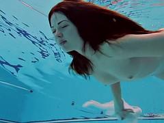 hot soroka takes her short dress underwater revealing her nude body