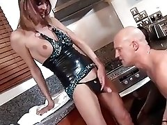 Naughty tranny and bald pervert fuck hard in the kitchen