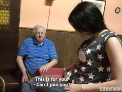 An old man with a hard dick is having sex with a slutty brunette