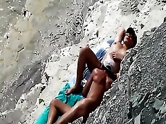 Husband eats out his wife on the beach
