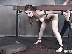 Slave girl spit roasted by strapon and his cock