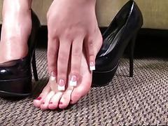 Gabriella Paltrova jerks off a BBC with her feet