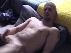 Muscled straight hunk pleasures himself in bedroom