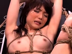 Helpless Oriental slut gets her tight holes stretched out