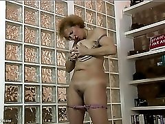Fondling her big mature tits and playing with her clit