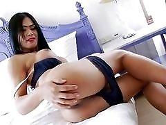 Brunette transvestite beats her dick and spreads her ass