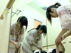 Cute Oriental ballerina reveals her slim body on hidden cam
