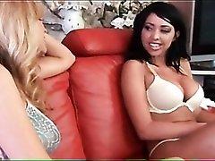 Milf kisses a big tits brunette in a bra