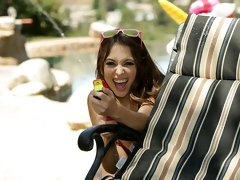 For a mischievous guy with a watergun, the temptation of sexy Riley Reid lying out in the sun wearing only an extremely tiny purple bikini is just too