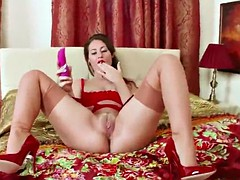 naughty jess west dildos herself in red lingerie retro nylon