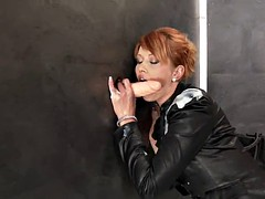alluring redhead plays with a glory hole dildo in a messy solo shoot