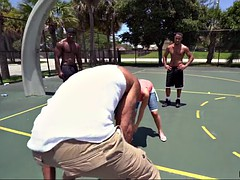 michelle martinez playing basketball with three black muscle dudes