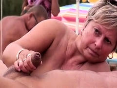 Lustful mature ladies deliver amazing blowjobs on the beach