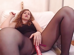 Webcam girl in black pantyhose fingers and squirts