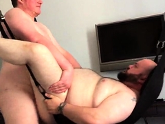 Two chubby gay lovers engage in hard anal sex on the bed