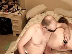 Amateur BDSM with masked fat man and a submissive woman