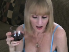 Melanie Sky starts this scene off with a glass of wine in