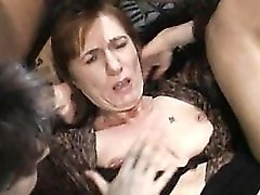 Dudes having an orgy with mature sluts