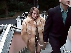 Sub girl in fur coat and leash