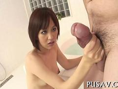 Slim Japanese porn star makes a chubby dudes knees clench