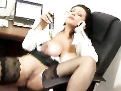 Wife chats on phone and uses toy