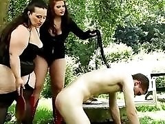 Skinny slave boy fucks with two fat bitches outside BDSM
