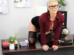Short-haired blonde in stockings Ryan Keely rides a huge dick