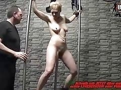 Maledom master plays with a tied up slave bitch BDSM