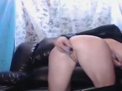 Hot redhead in leather uses toy